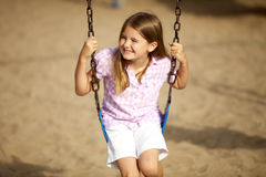 Girl Swinging Stock Photos