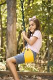 Girl swinging. Stock Photos