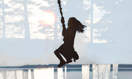 Girl swinging bungee. Child swinging bungee Royalty Free Stock Photography