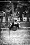 Girl swinging in Central park. New York, USA Stock Photo
