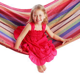 Girl swinging on a hammock Stock Images