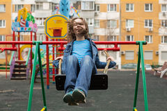 Girl swinging. Royalty Free Stock Images
