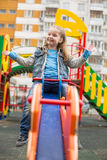 Girl swinging. Royalty Free Stock Photo