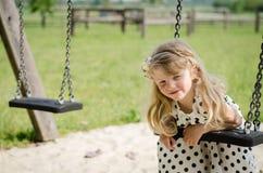 Girl swinging Stock Photo