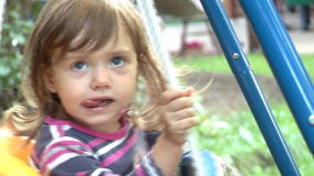 Girl Swinging Outdoors stock footage