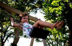 Girl swinging Stock Photos