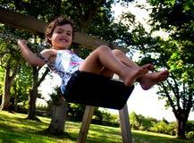 Girl swinging Royalty Free Stock Image