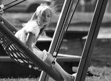 Girl swinging Stock Images