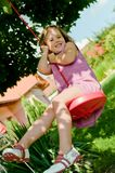Girl swinging on seesaw Royalty Free Stock Photo
