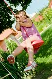 Girl swinging on seesaw Royalty Free Stock Images