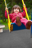 Girl swinging on a swing. In the park Stock Photo