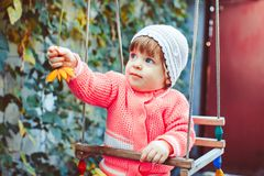 Child on the swing Stock Photos