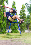 Girl swinging swing in the garden. Royalty Free Stock Photo