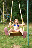 Girl swinging on a swing Stock Image