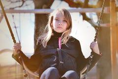 Girl swinging Royalty Free Stock Photography