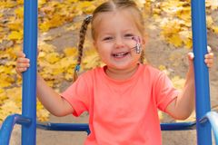 Girl swinging on swing and smiling in camera stock photos