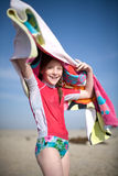 Girl swinging towel overhead Royalty Free Stock Image