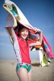 Girl swinging towel overhead Royalty Free Stock Image