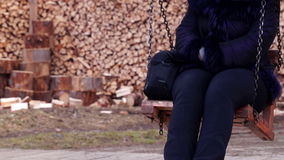 Girl Swinging on a Wooden Swing stock footage