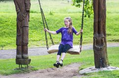 Girl swinging Royalty Free Stock Image