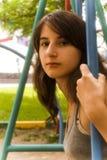 Girl on the swings Stock Photos