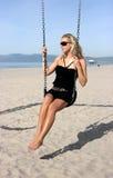 Girl on swings Stock Photography
