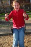 Girl on swings Stock Photos