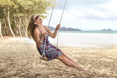 Girl swings and laughs playfully Stock Images