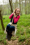 Girl swings on rope Stock Images