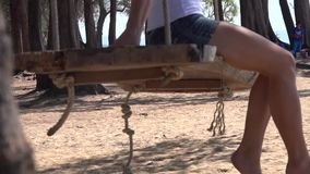 Girl on swings stock video footage