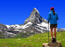 Girl in the Swiss Alps. Girl looking at the beautiful Mount Matterhorn in the Swiss Alps royalty free stock image