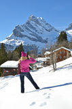 Girl in Swiss Alps. Girl with a camera in Swiss Alps Royalty Free Stock Photography