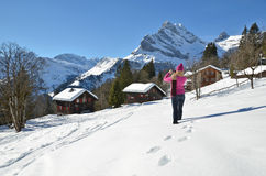 Girl in Swiss Alps. Girl with a camera in Swiss Alps Stock Photos