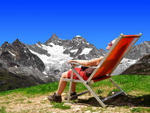 Girl in the Swiss Alps. On the background Mount Gabelhorn royalty free stock photography