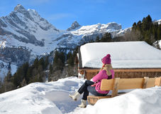 Girl in Swiss Alps. Girl with a camera in Swiss Alps Royalty Free Stock Images