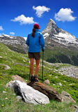 Girl in the Swiss Alps. Girl looking at the beautiful Mount Matterhorn Stock Photos
