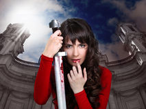 Girl with a sword in hands Stock Photography