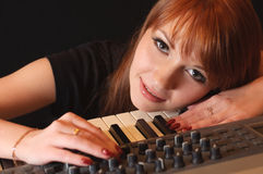 Girl with synthesizer Royalty Free Stock Photography