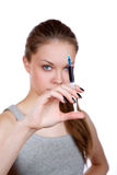 Girl about a syringe in hand. On white background royalty free stock photos