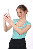 Girl in T-shirt and skirt taking selfie. Close up. White background Royalty Free Stock Photo
