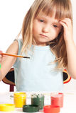 Girl at the table. Little girl sitting at the table and painting Stock Photography
