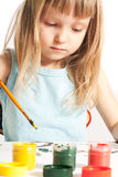 Girl at the table. Little girl sitting at the table and painting Stock Photo
