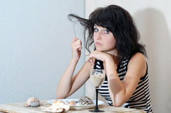 Girl at the table Royalty Free Stock Images