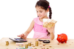 Girl at the table counts money Stock Photography