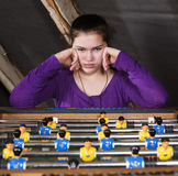 Girl at table football Stock Images