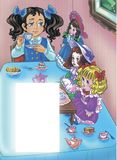 Girl at the table with her dolls dreanking tea Stock Photography