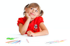 Girl at table with pencils, paints and scissors Royalty Free Stock Photography