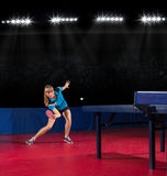 Girl table tennis player (interior ver) Royalty Free Stock Images