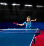 Girl table tennis player at sport hall Stock Photography