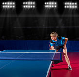 Girl table tennis player at sport hall Stock Image